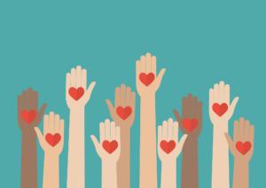 Volunteer hands with hearts