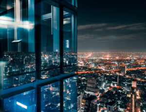 Glass window with glowing crowded city,concept: power the resilience imperative